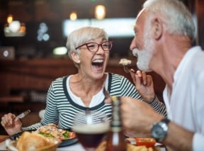 woman laughing & eating with her husband 5 reasons to self directed ira - BLOG